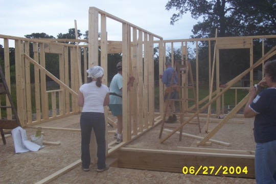 Inside walls going up with help from family
