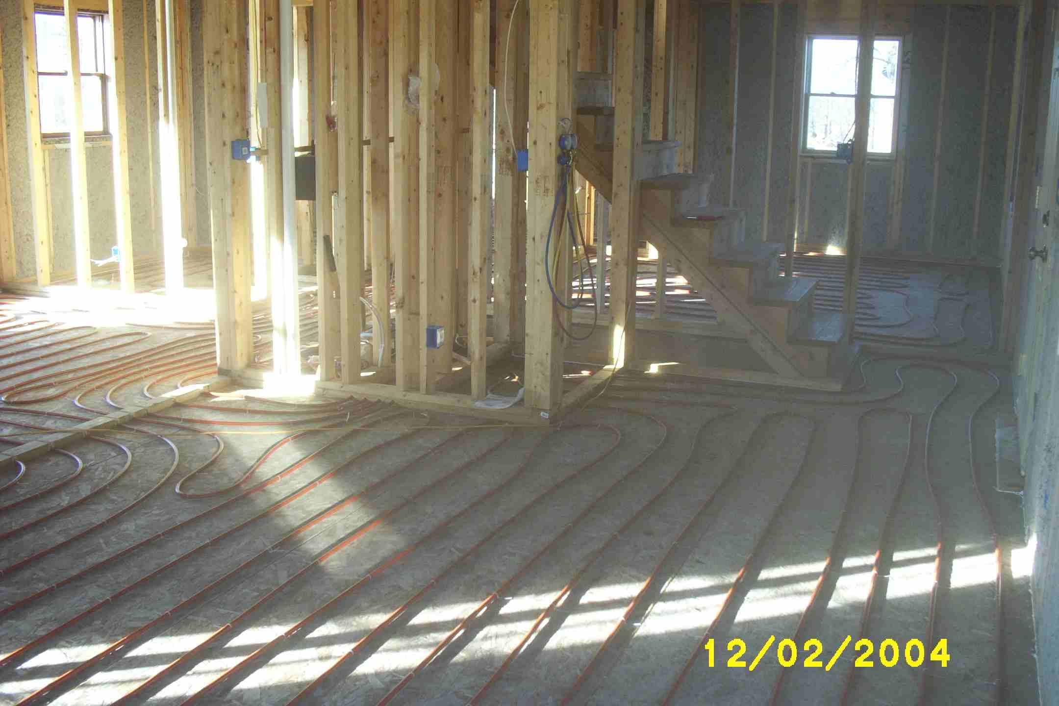 You can see tubing on the floor and newspaper insulation in the walls in this picture